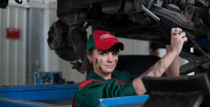 female fixing car